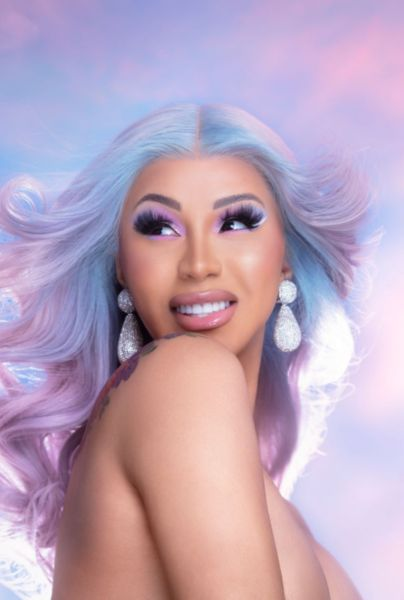 Cardi B posing with a unicorn background